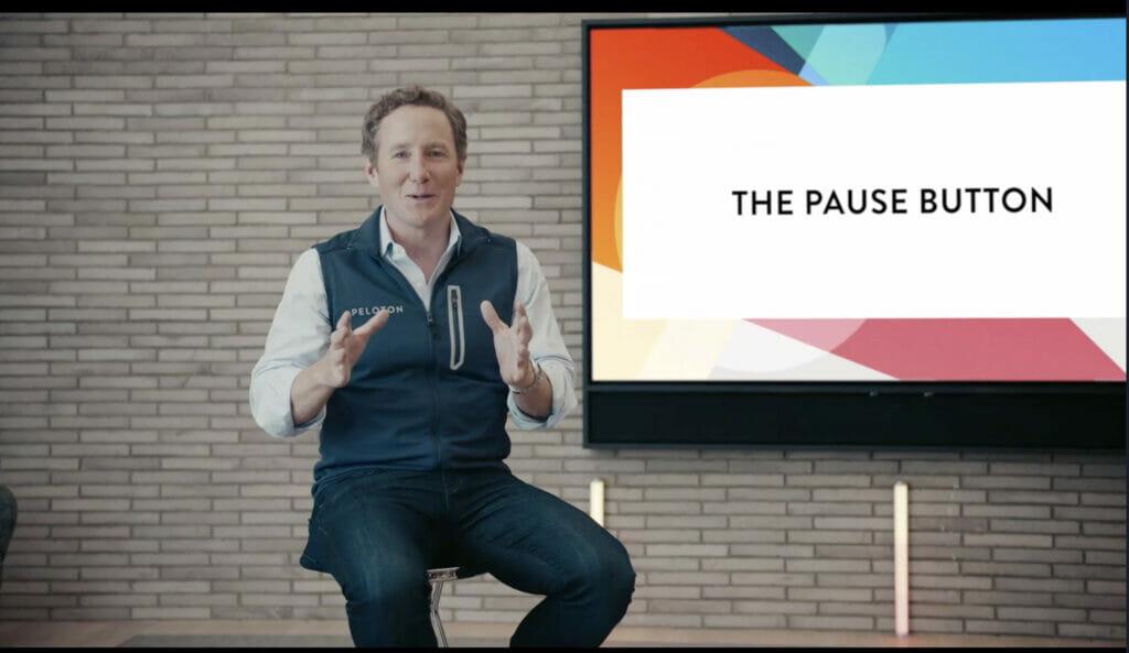 John Foley announcing a Peloton pause button.