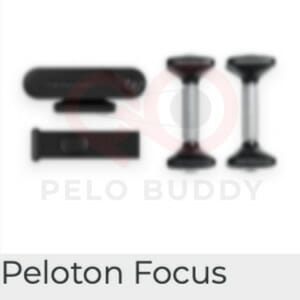 Image of the Peloton Focus strength device. Shown with weights and a resistance band.